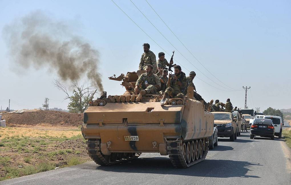 Syrian troops enter town of Kobani on border with Turkey